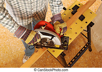 carpenter at work detail - closeup image of manual worker...