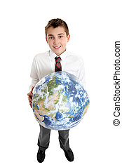 Smiling boy holding the world earth