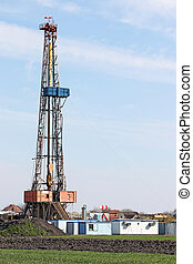 land oil drilling rig on oilfield
