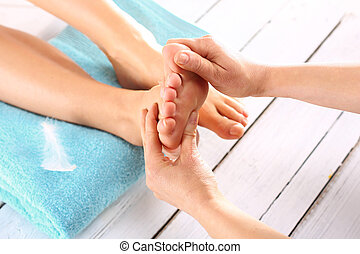 Foot massage - Woman in a beauty salon for pedicure and foot...