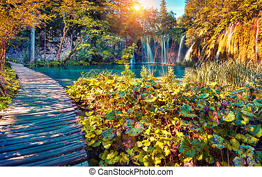 Colorful autumn sunrise in the Plitvice Lakes National Park....