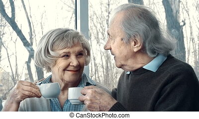 Tea Party for Two - Close up of senior couple having tea and...