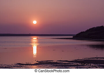 The sun goes down over the East Fleet in Dorset - Red sky is...