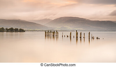 Loch Lomond jetty and mountains at sunset - Long exposure of...