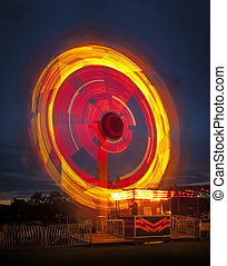 Fairground ride at night - Long exposure of a fairground...