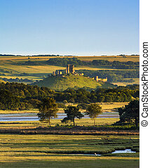 Corfe Castle and Poole Harbour - Corfe Castle stands high on...