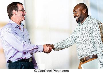Diverse Business partners shaking hands - Close up portrait...