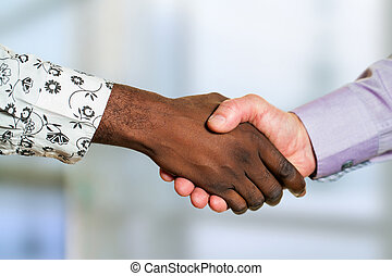 Detail of diverse business handshake. - Close up detail of...
