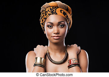 African queen. Beautiful African woman wearing a headscarf...