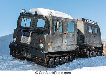 articulated military tracked cargo vehicle on snow -...