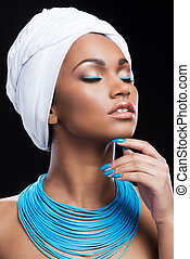 African beauty in style. Beautiful African woman wearing a...