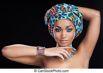 Traditional beauty. Beautiful African woman in headscarf and...