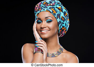 In love with her style. Beautiful African woman wearing a...