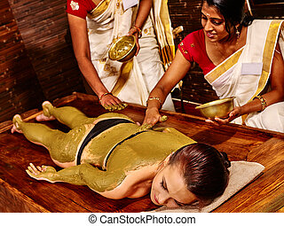 Woman having Ayurvedic body spa massage. - Young woman...