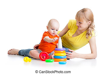 kid boy and mother play together with toy