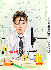 tired of chemistry - A boy tired of working in the...