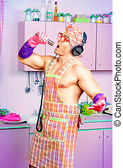 chef singer - Funny and handsome muscular man in an apron...