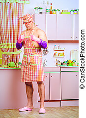 defender - Attractive muscular man in an apron stands in the...