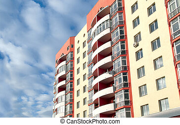 apartment building - modern apartment building on blue sky...