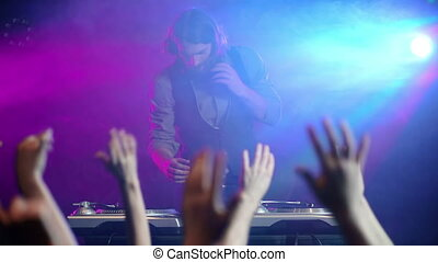 Put your Hands up - Front view of disc jockey playing and...