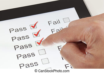 Completing the form on a digital tablet, clicking all pass