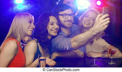 Take a Selfie - Close up of five friends posing for a selfie...