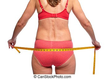 Woman measuring body fat.
