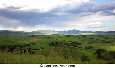 Landscape in Tuscany with the house and vineyards in may