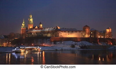 Wawel castle in night illumination in the winter Krakow,...