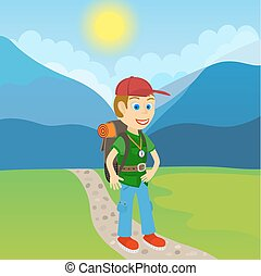 Young man tourist with backpack standing on a path at the foot of mountain