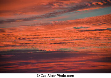 Pink and orange clouds at sunrise