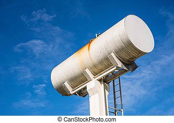 Large white water storage tank.
