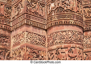 Stone carving on Qutab Minar Delhi, India