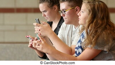 Friends students using smartphone - High school friends...