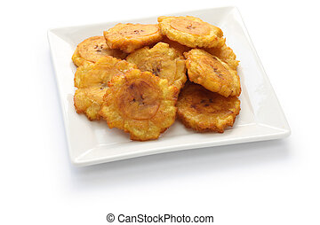 fried green plantain banana chips - tostones, patacones,...