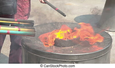Burning joss sticks in Yuyuan Garden in Shanghai