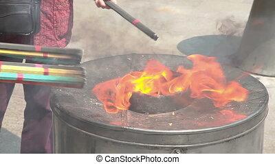 Burning joss sticks in Yuyuan Garden in Shanghai