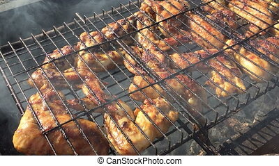 chicken wings grilling - Frying chicken wings on the grill...