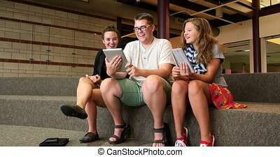Students using newer technology UHD - High school friends...