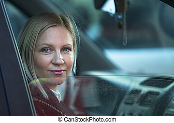 Woman sitting in the car.