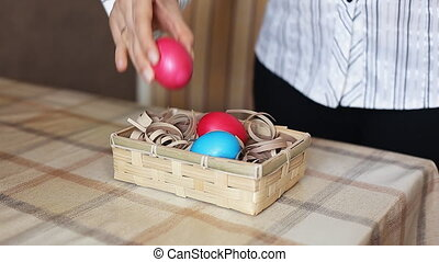 Basket with eggs in woman hands eggs lays