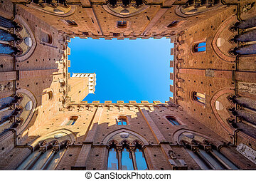 famous Torre del Mangia in Siena, Italy