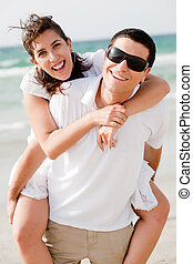 Young man piggyback his girlfriend