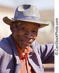 Golden age - Portrait of elderly african man with a broken...