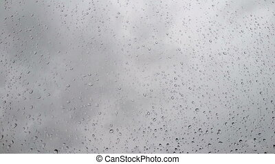 Drops on the glass in cloudy weather - Timelapse Drops on...