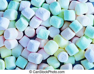 marshmallows - color marshmallows on the wooden table, color...