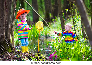 Kids playing with frog - Children playing outdoors Two...