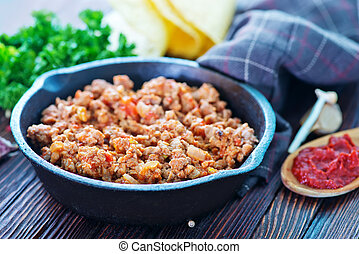 fried ground meat - a bowl of fried ground meat with...