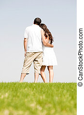 Rear view of romantic young couple standing