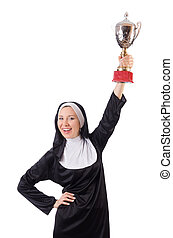 Pretty nun holding winner cup isolated on white